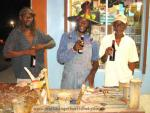 Three Garifuna partiers in hats.