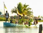 Small boat filled with Garifuna celebrators.