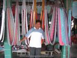 Vendor proudly shows his hammock display