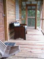 Comfy seat on screened in porch