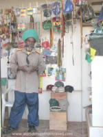 Rasts in front of his shop in Belize City