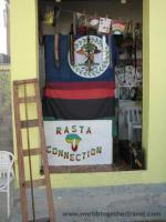Flag sign saying Rasta Connection with a map of Africa in red, green and gold