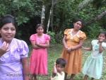 four young Mayan women all in different colored dresses