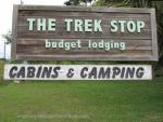 Trek Stop sign, cabins and camping