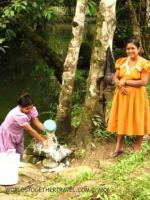 Two Mayan women doing laundry in a river