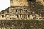 Mayan carvings on wall of ruins